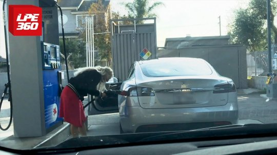 Woman tries putting gas in a Tesla